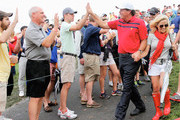 Phil Mickelson of the U.S. Team walks with his wife Amy walk off the 17th hole after the team of Mickelson/Bradley defeated the Els/de Jonge team 2&1 during the Day Three Four-ball Matches at the Muirfield Village Golf Club on October 5, 2013  in Dublin, Ohio.