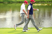 Jordan Spieth (L) and Dustin Johnson of the United States Team walk on the fourth fairway during the Saturday foursomes matches at The Presidents Cup at Jack Nicklaus Golf Club Korea on October 10, 2015 in Songdo IBD, Incheon City, South Korea.