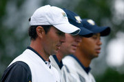 Mike Weir of the International Team walks alongside Steve Stricker and Tiger Woods of the USA Team during the Day Three Morning Foursome Matches of The Presidents Cup at Harding Park Golf Course on October 10, 2009 in San Francisco, California.