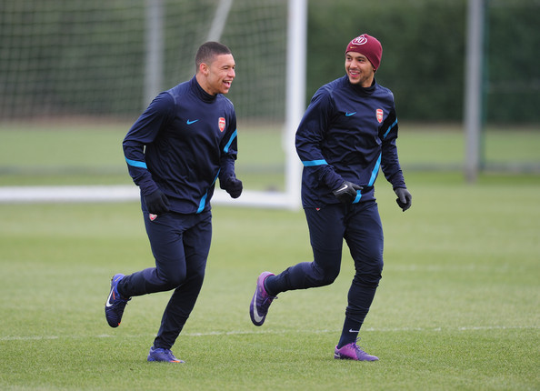 Theo Walcott Alex Oxlade-Chamberlain (L) and Theo Walcott of Arsenal warm-up during a training session at London Colney on February 14, 2012 in St Albans, England.