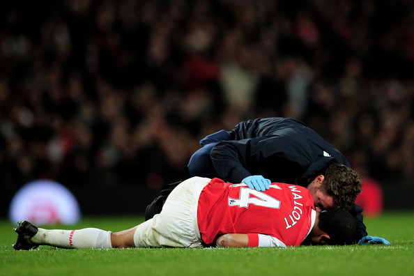 Theo Walcott Theo Walcott of Arsenal receives medical attention during the Barclays Premier League match between Arsenal and Stoke City at the Emirates Stadium on February 23, 2011 in London, England.