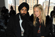 Designer and actor Waris Ahluwalia (L) and Vogue marketing editor Meredith Melling Burke attend the Theory fashion show during Mercedes-Benz Fashion Week Fall 2014 at Spring Studios on February 10, 2014 in New York City.