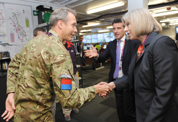 Theresa May and Colonel Gary Wilkinson Photos Photos - Home