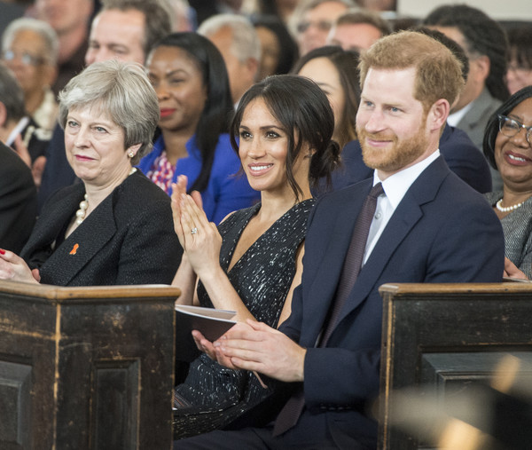 Prince Harry And Meghan Markle Attend The 25th Anniversary Of Stephen Lawrence Memorial Service [people,event,audience,management,crowd,employment,official,ceremony,government,gesture,prince harry,theresa may,meghan markle attend the 25th anniversary of stephen lawrence memorial service,gang,murder victim,racists,memorial service,london,l,murder]