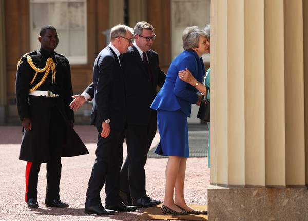 Queen Receives Outgoing And Incoming Prime Ministers [susan hussey,theresa may,philip may,queen,prime ministers,prime minister,private secretary,monarch,number,uniform,event,official,gesture,tourism,major]