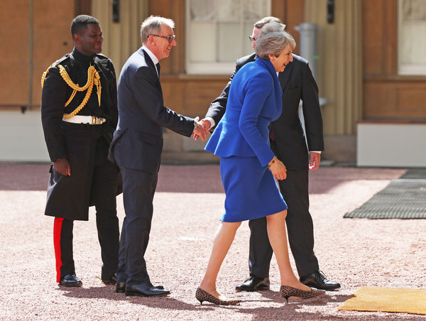Queen Receives Outgoing And Incoming Prime Ministers [uniform,interaction,gesture,event,suit,official,white-collar worker,tourism,conversation,formal wear,philip may,theresa may,queen,prime ministers,prime minister,private secretary,monarch,number,palace,major]