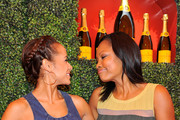 Actresses Dania Ramirez (L) and Garcelle Beauvais arrive at the Third Annual Veuve Clicquot Polo Classic at Will Rogers State Historic Park on October 6, 2012 in Pacific Palisades, California.