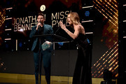 Jonathan Bennett (L) and Missi Pyle speak onstage at Thirst Project 10th Annual Thirst Gala at The Beverly Hilton Hotel on September 28, 2019 in Beverly Hills, California.