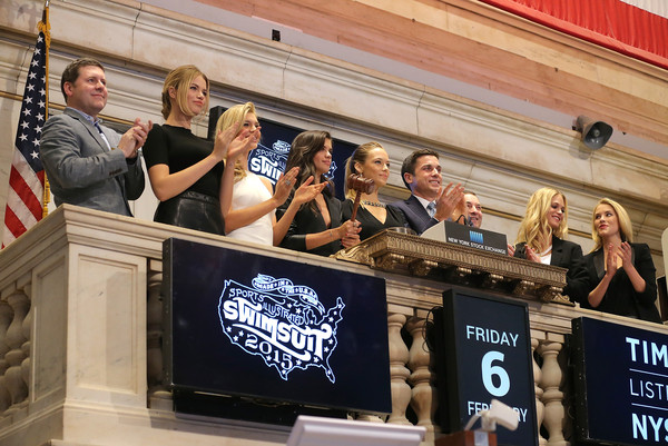 'SI' Swimsuit Models Ring the NYSE Closing Bell [advertising,event,banner,team,swimsuit models,swimsuit models,closing bell,thomas farley,si,l-r,nyse,time inc,new york stock exchange,group publisher]