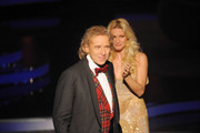 "Thomas Gottschalk says good-bye to the audience as Michelle Hunziker applauds him during the 199th ""Wetten dass...?"" show at the Rothaus Hall on December 3, 2011 in Friedrichshafen, Germany. After 24 years host Thomas Gottschalk terminates today his career as ""Wetten dass...?"" moderator."