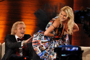 "Michelle Hunziker presents a surprise dress to Thomas Gottschalk make out of pictures from his outfits during the 199th ""Wetten dass...?"" show at the Rothaus Hall on December 3, 2011 in Friedrichshafen, Germany. After 24 years host Thomas Gottschalk terminates today his career as ""Wetten dass...?"" moderator."