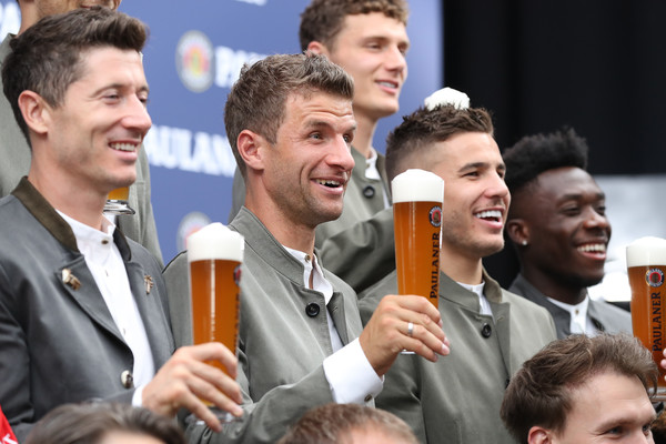 FC Bayern Muenchen And Paulaner Photo Session [facial expression,people,product,event,crowd,team,gesture,thomas mueller,munich,germany,fc bayern muenchen,paulaner,fgv schmidtle studios,photo session,photo session]