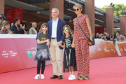 """Giampaolo Letta (2nd L) and Rossana Ridolfi  (R)  walks the red carpet ahead of the """"Ti Presento Sofia"""" screening during the 13th Rome Film Fest at Auditorium Parco Della Musica on October 20, 2018 in Rome, Italy."""