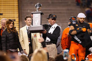 Head coach Mike Gundy of the Oklahoma State Cowboys holds up the TicketCity Cactus Bowl trophy after defeating the Washington Huskies at Sun Devil Stadium on January 2, 2015 in Tempe, Arizona. The Cowboys defeated the Huskies 30-22.