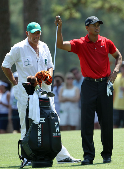 Tiger Woods Tiger Woods pulls a club in the first fairway as his caddie Steve Williams looks on during the final round of the 2011 Masters Tournament at Augusta National Golf Club on April 10, 2011 in Augusta, Georgia.