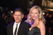 Director Andrew Niccol and Rachel Roberts arrives at the UK premiere of 'In Time' at The Curzon Mayfair on October 31, 2011 in London, England.