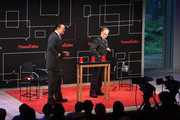 (L-R) American illusionists Penn Jillette and Raymond Joseph Teller perform at 'Time Talks Presents: An Evening With Penn and Teller'  at The Times Center on July 2, 2015 in New York City.