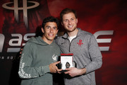 Marc Marquez, five-time MotoGP World Champion and brand ambassador for Tissot, Official Watch and Timekeeper of the Houston Rockets and MotoGP, presents a watch to Patrick Fertitta of the Houston Rockets at the Houston Rockets game against the Phoenix Suns at Toyota Center on April 7, 2019 in Houston, Texas.