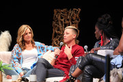 (L-R) Glennon Doyle listens to Abby Wambach speak at the Together Live event at the Pantages Theatre on October 21, 2019 in Minneapolis, Minnesota.