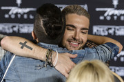 Bill Kaulitz (R) hugs a fan after the Tokio Hotel Press Conference & Photocall on October 2, 2014 in Berlin, Germany. After a five year break, the new Tokio Hotel record 'Kings Of Suburbia' will be released on October 3.