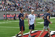 Cyclist George Hincapie (L) attends the Tom Brady Football Challenge for The Best Buddies Challenge: Hyannis Port 2015 at Harvard Field on May 29, 2015 in Allston, Massachusetts.
