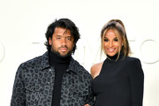 (L-R) Russell Wilson and Ciara attend the Tom Ford AW20 Show at Milk Studios on February 07, 2020 in Hollywood, California.