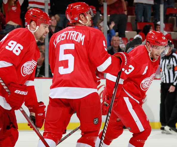 Tomas Holmstrom Tomas Holmstrom #96 of the Detroit Red Wings celebrates his second-period goal with teammates Nicklas Lidstrom #5 and Pavel Datsyuk #13 while playing the San Jose Sharks at Joe Louis Arena on October 28, 2011 in Detroit, Michigan. San Jose won the game 4-2.
