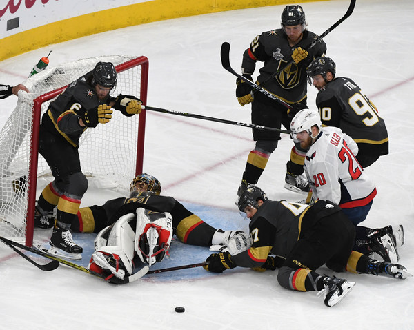 2018 NHL Stanley Cup Final - Game Five [shot,player,college ice hockey,ice hockey,ice hockey position,sports,hockey,hockey protective equipment,ice hockey equipment,sports gear,team sport,colin miller,five,l-r,net,front,washington capitals,vegas golden knights,nhl,stanley cup final]