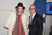 Irene Kim and designer Tommy Hilfiger pose backstage at Tommy Hilfiger Women's during Mercedes-Benz Fashion Week Fall 2015 at Park Avenue Armory on February 16, 2015 in New York City.