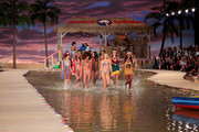 Models walk through water at Tommy Hilfiger Women's Spring 2016 during New York Fashion Week: The Shows  at Pier 36 on September 14, 2015 in New York City.