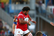 PJ Van Lill of Namibia tackles David Halaifonua of Tonga during the 2015 Rugby World Cup Pool C match between Tonga and Namibia at Sandy Park on September 29, 2015 in Exeter, United Kingdom.