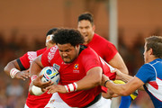 Tonga replacement PJ Van Lill barges through the tackle of Johan Deysel of Namibia during the 2015 Rugby World Cup Pool C match between Tonga and Namibia at Sandy Park on September 29, 2015 in Exeter, United Kingdom.