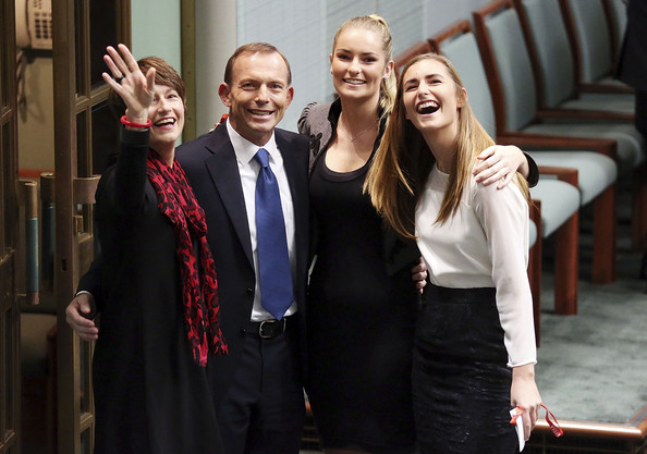 Tony Abbott Delivers Budget Reply Speech [tony abbott,tony abbott delivers budget reply speech,family,photographers,budget reply,carbon tax,surplus,plans,event,suit,formal wear,fun,white-collar worker,gesture,smile,coalition government,government]