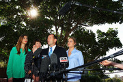 Opposition Leader Tony Abbott speaks to the media as his family, Frances, Margie and Bridget look on at Bear Cottage in Sydney on September 1, 2013 in Sydney, Australia. Australian voters will head to the polls on September 7 to elect the 44th parliament.
