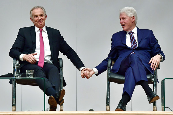 News Pictures Of The Week - October 18 [the week,news pictures,good friday agreement,event,public speaking,speech,businessperson,conversation,white-collar worker,spokesperson,orator,sitting,business,bill clinton,tony blair,hands,us,belfast,event,building peace]