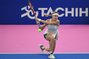 Eugenie Bouchard of Canada plays a backhand against Alison Riske United States during their WomenÕs singles first round match on day two of the Toray Pan Pacific Open at Arena Tachikawa Tachihi on September 18, 2018 in Tachikawa, Tokyo, Japan.