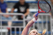 Eugenie Bouchard of Canada serves against Alison Riske United States during their WomenÕs singles first round match on day two of the Toray Pan Pacific Open at Arena Tachikawa Tachihi on September 18, 2018 in Tachikawa, Tokyo, Japan.
