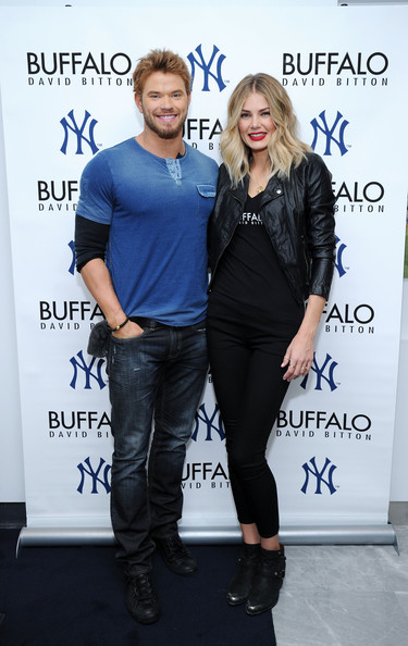Kellan Lutz Presents a Giant Check [clothing,fashion,footwear,event,outerwear,jeans,shoe,fashion design,performance,style,kellan lutz,buffalo david bitton,tori praver,check,yankee stadium,new york city,the new york yankees foundation on behalf of the brand]