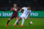 Armando Izzo (L) of Torino FC competes with Fabio Quagliarella of UC Sampdoria during the Serie A match between Torino FC and UC Sampdoria at Stadio Olimpico di Torino on April 3, 2019 in Turin, Italy.