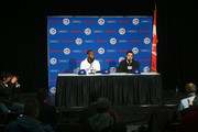 Jose Reyes #7 (L) of the Toronto Blue Jays is introduced at a press conference as general manager Alex Anthopoulos answers a question from a reporter at Rogers Centre on January 17, 2013 in Toronto, Ontario.