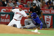 Cliff Pennington #7 of the Los Angeles Angels of Anaheim tags out Troy Tulowitzki #2 of the Toronto Blue Jays as he attempts to steal third base during the eighth inning of a game at Angel Stadium of Anaheim on April 21, 2017 in Anaheim, California.