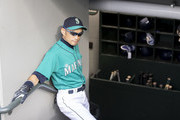 Ichiro Suzuki #51 of the Seattle Mariners stands in the dugout before a game against the Toronto Blue Jays at Safeco Field on August 3, 2018 in Seattle, Washington. The Blue Jays won the game 7-2.