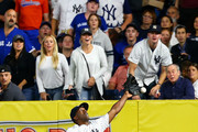 Andrew McCutchen #26 of the New York Yankees is unable to catch a double off the bat of Devon Travis #29 of the Toronto Blue Jays in the seventh inning at Yankee Stadium on September 14, 2018 in the Bronx borough of New York City.