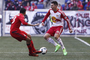 Sacha Kljestan #16 of New York Red Bulls dribbles past Steven Beitashour #33 of Toronto FC  during their match at Red Bull Arena on March 6, 2016 in Harrison, New Jersey.