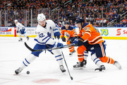 Matthew Benning #83 of the Edmonton Oilers defends against Tyler Bozak #42 of the Toronto Maple Leafs at Rogers Place on November 30, 2017 in Edmonton, Canada.