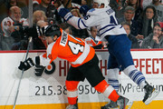 Kimmo Timonen #44 is checked by Joey Crabb #46 of the Toronto Maple Leafs in the first period of an NHL hockey game at Wells Fargo Center on February 9, 2012 in Philadelphia, Pennsylvania.