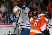Joey Crabb #46 of the Toronto Maple Leafs tries to get around Erik Gustafsson #26 of the Philadelphia Flyers as he chases the puck in the third period of an NHL hockey game at Wells Fargo Center on February 9, 2012 in Philadelphia, Pennsylvania.