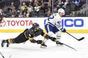 Tyler Bozak #42 of the Toronto Maple Leafs and Colin Miller #6 of the Vegas Golden Knights skate to the puck during the game at T-Mobile Arena on December 31, 2017 in Las Vegas, Nevada.