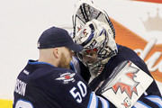 Chris Mason and Ondrej Pavelec Photos Photo