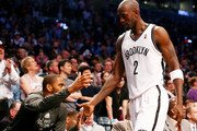 Kevin Garnett #2 of the Brooklyn Nets is greeted by teammate Alan Anderson #6 after Garnett heads for the bench in Game Three of the Eastern Conference Quarterfinals during the 2014 NBA Playoffs at the Barclays Center on April 25, 2014 in the Brooklyn borough of New York City.The Brooklyn Nets defeated the Toronto Raptors 102-98. NOTE TO USER: User expressly acknowledges and agrees that, by downloading and/or using this photograph, user is consenting to the terms and conditions of the Getty Images License Agreement.